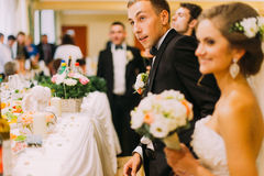 Handsome groom holding redemption of bride on wedding indoors Royalty Free Stock Image