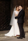 Handsome groom hugging bride, newlywed couple, blonde wife and s Royalty Free Stock Images
