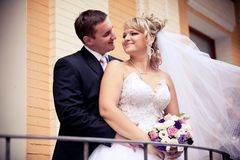 Handsome groom hugging his bride from on street Royalty Free Stock Photography