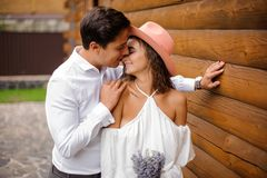 Handsome groom kissing beautiful bride on nose Royalty Free Stock Photos