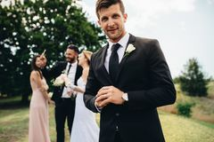 Handsome groom looking happy on his wedding day stock images