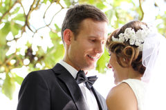 Handsome groom looking lovingly into bride eyes Royalty Free Stock Image