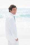 Handsome groom looking over his shoulder to camera Royalty Free Stock Photography