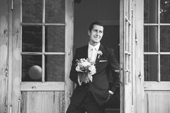 Handsome groom with a nice wedding bouquet stock images