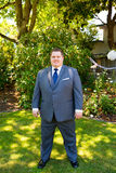 Handsome Groom Portraits. Portraits of a groom on his wedding day while waiting for his bride at a park outdoors in Oregon before the ceremony Royalty Free Stock Photo