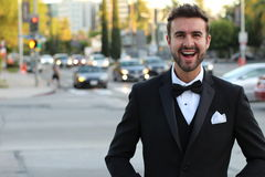Handsome groom smiling outside Royalty Free Stock Photo