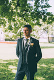 Handsome groom at wedding tuxedo smiling and waiting for bride. Happy smiling groom newlywed Royalty Free Stock Photos