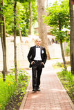 Handsome groom at wedding tuxedo smiling and Royalty Free Stock Images