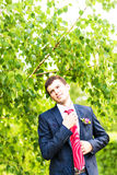 Handsome groom at wedding tuxedo smiling and waiting for bride. Happy smiling groom newlywed. Rich groom at wedding day Stock Photos