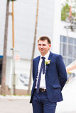 Handsome groom at wedding tuxedo smiling and waiting for bride. Happy smiling groom newlywed. Rich groom at wedding day Royalty Free Stock Photos