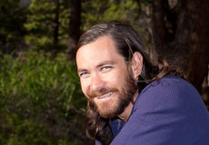 Handsome guy. Handsome young man with long hair in nature Royalty Free Stock Photography