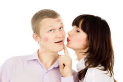 A handsome guy asks his girl kiss him Stock Images