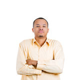 A handsome guy with a bad attitude, arms crossed Stock Images
