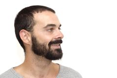 Handsome guy. With beard and gray shirt on white background Stock Photos
