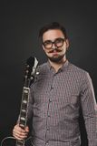 Handsome guy with beard holding acoustic guitar Royalty Free Stock Photo