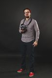 Handsome guy with beard holding vintage camera Royalty Free Stock Photos
