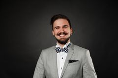 Handsome guy with beard and mustache in suit. On dark background in studio Royalty Free Stock Photography