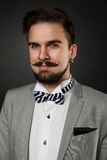 Handsome guy with beard and mustache in suit Stock Photography
