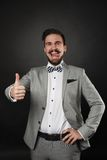 Handsome guy with beard and mustache in suit. On dark background in studio Stock Images