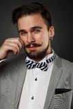 Handsome guy with beard and mustache in suit Royalty Free Stock Photography
