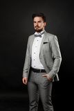 Handsome guy with beard and mustache in suit. On dark background in studio Stock Photo