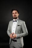 Handsome guy with beard and mustache in suit Stock Images
