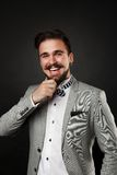 Handsome guy with beard and mustache in suit. On dark background in studio Royalty Free Stock Photo