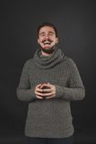 Handsome guy with beard in wool pullover. Handsome guy with beard and mustache in wool pullover on dark background in studio Stock Photography