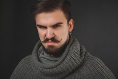 Handsome guy with beard in wool pullover Royalty Free Stock Photos