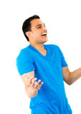 Handsome guy in blue shirt laughing Stock Photo