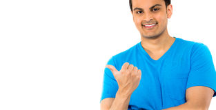 Handsome guy in blue shirt pointing Stock Photography