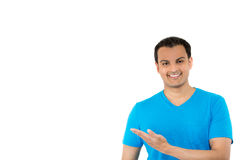 Handsome guy in blue shirt pointing Stock Images