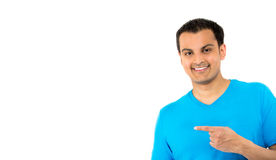 Handsome guy in blue shirt pointing Royalty Free Stock Image