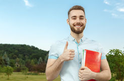 Handsome guy with a book in the park Royalty Free Stock Photography
