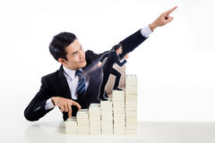 Handsome guy in business suit show finger walking up the stair a Royalty Free Stock Images