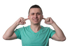 Handsome Guy Closing Ears With His Fingers Stock Photo