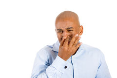 handsome guy closing nose because something stinks Stock Photography