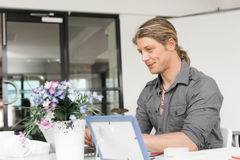 Handsome guy at computer work Royalty Free Stock Photos