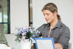Handsome guy at computer work Stock Images