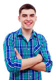 Handsome guy with crossed arms over white Stock Photos