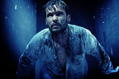 Handsome guy in a dirty white shirt Royalty Free Stock Photography