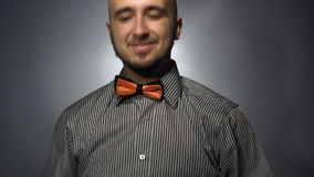 Handsome guy dress bow tie stock video footage