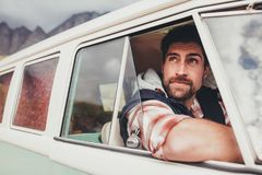 Handsome guy driving a minivan royalty free stock photos