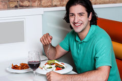 Handsome guy enjoying his meal Royalty Free Stock Photos