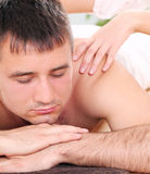 Handsome guy enjoying massage therapy. Young and handsome guy enjoying massage therapy Royalty Free Stock Image