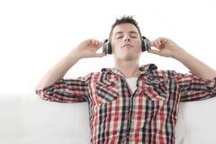 Handsome guy enjoying music on headphones Stock Image