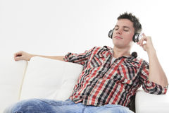 Handsome guy enjoying music on headphones Stock Images