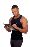 Handsome guy filling the form of the gym Stock Photography