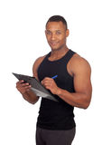 Handsome guy filling the form of the gym Royalty Free Stock Photography