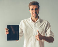 Handsome guy with gadget Royalty Free Stock Images